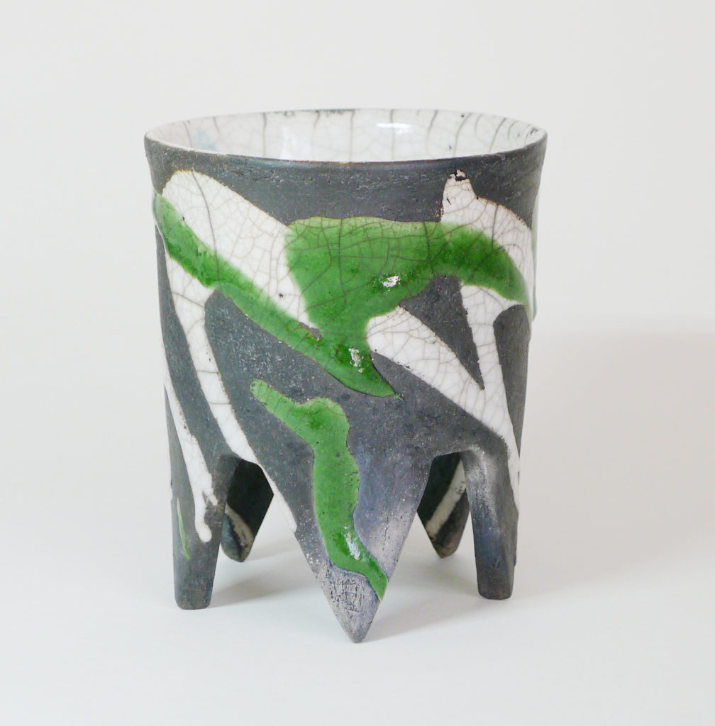 Deana Moore raku pot with pointed feet in green and clear glaze